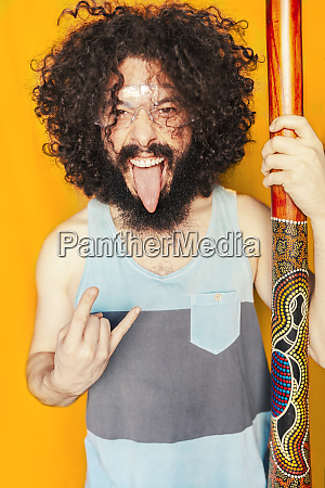 crazy man with curly hair holding