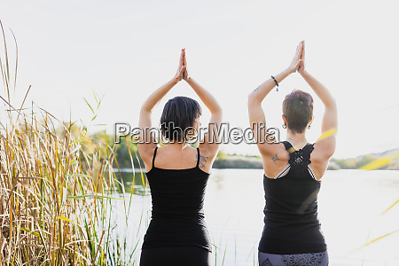 female friends with arms raised exercising