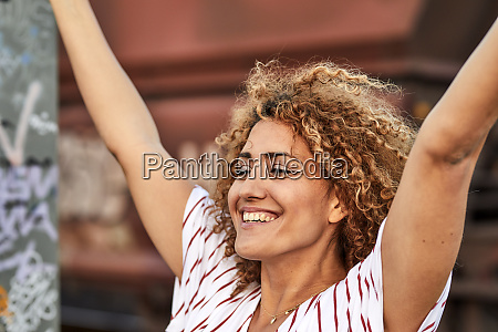 portrait of smiling woman with raised