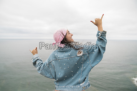 female cancer survivor smiling and dancing