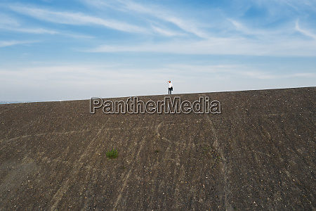 male entrepreneur standing on hill against