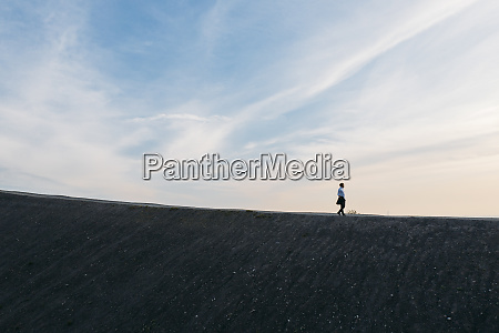 male entrepreneur walking on hill against