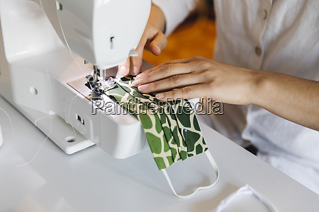 woman sewing homemade face mask