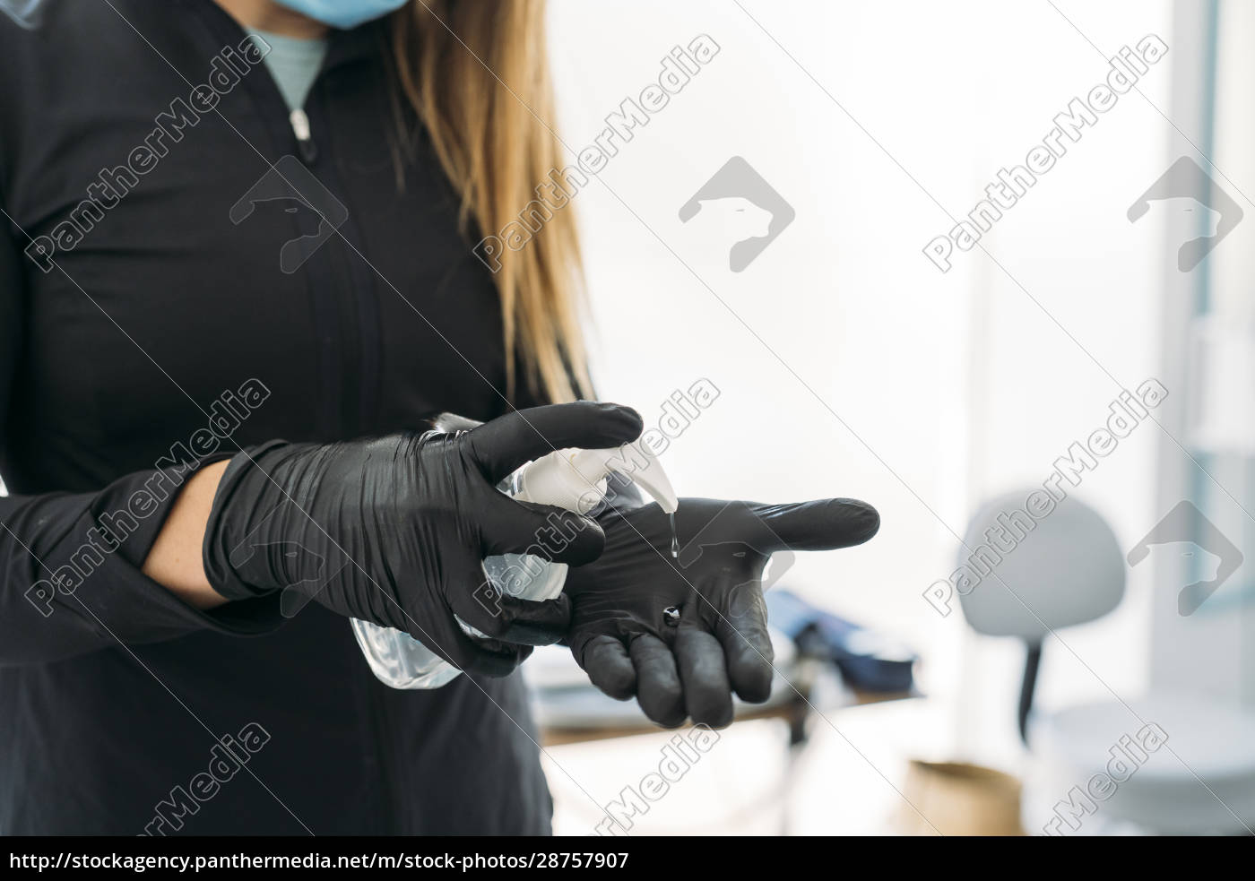 woman, wearing, protectivegloves, using, hand, sanitizer - 28757907