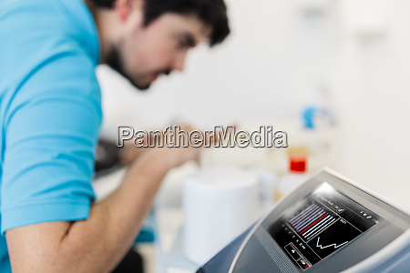 visually impaired physiotherapist using electro stimulation