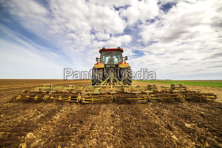 back view of farmer in tractor