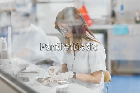 confident female technician preparing for research