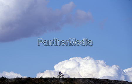 silhouette cyclist riding bicycle on field
