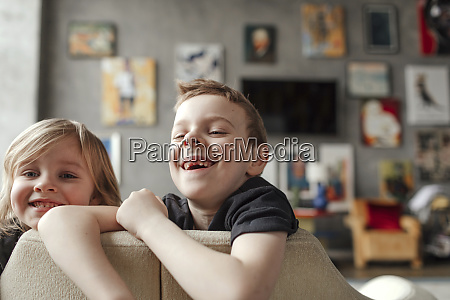 cheerful brothers enjoying in living room