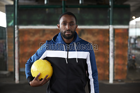 young man with yellow football