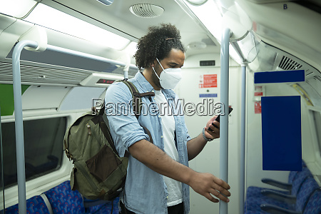 man wearing protective mask standing in