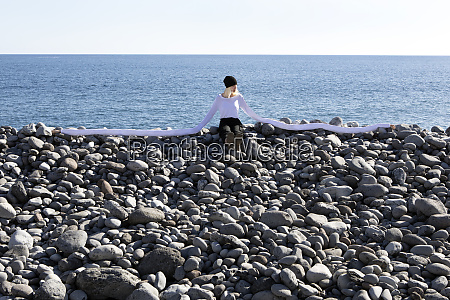 woman with artificial long hands sitting
