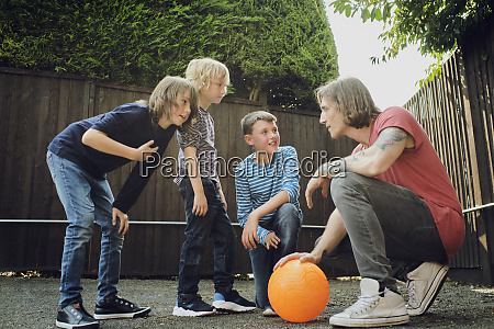 man and boys discussing strategy over
