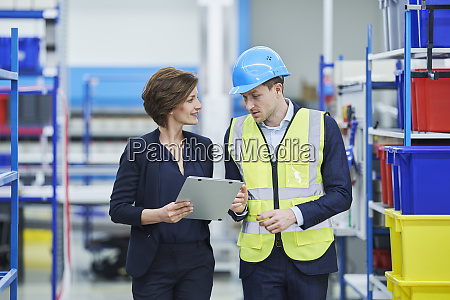 supervisor and female manager discussing over