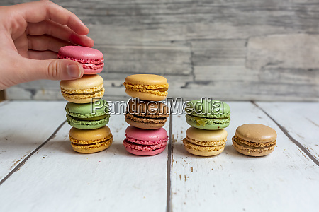 hand of person picking up macaroon