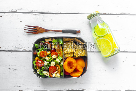 lunch box with rocket salad with