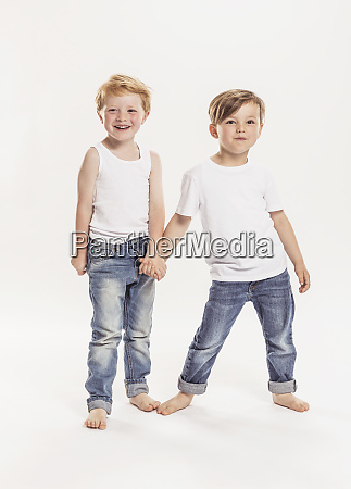 portrait of two little boys holding