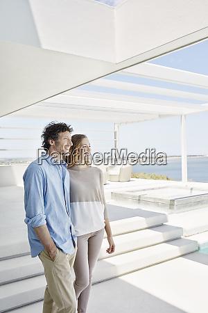 couple at luxury beach house enjoying