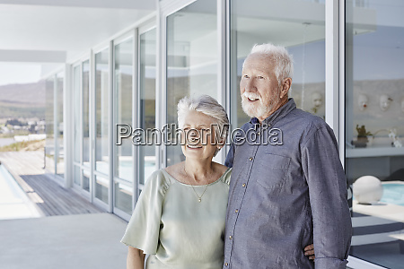 happy senior couple standing at luxury