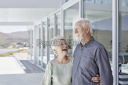 happy senior couple at luxury beach