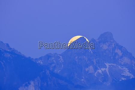germany bavaria moon hiding behind peaks