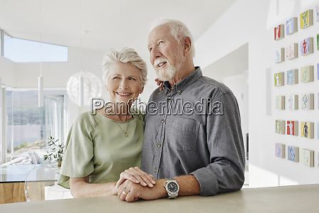 smiling senior couple in a luxury