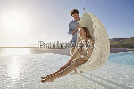 happy couple with woman sitting in