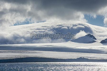 clouds over coastal glaciers of tabarin