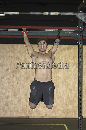 athlete with an amputated arm doing