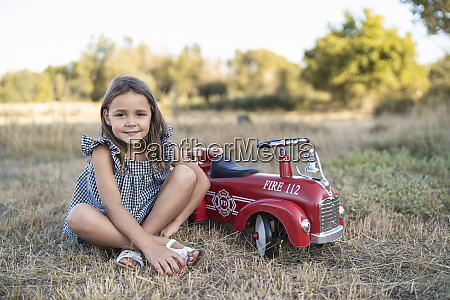 portrait of little girl with pedal