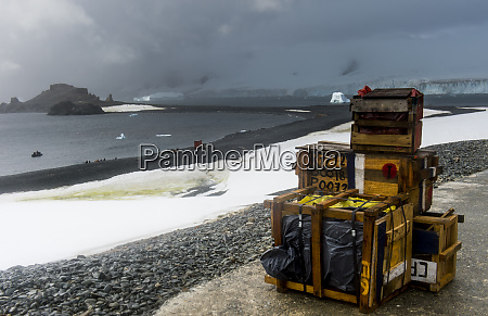 wooden cargo containers left on shore