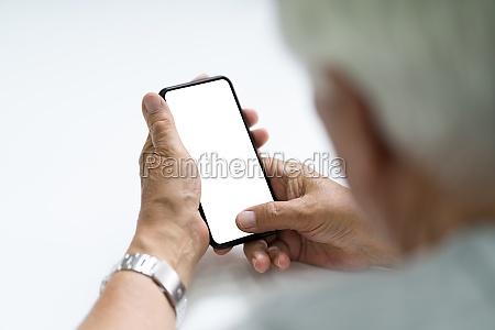 elderly senior hand using cell phone
