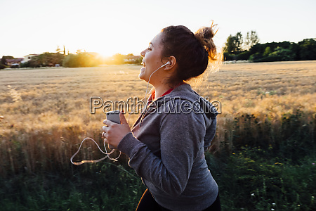 woman jogging and listening to music