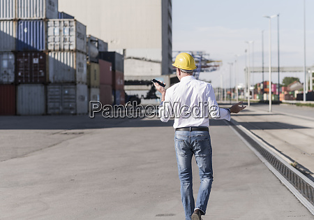 back view of businessman wearing safety