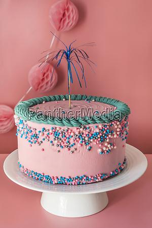 cake stand with strawberry birthday cake