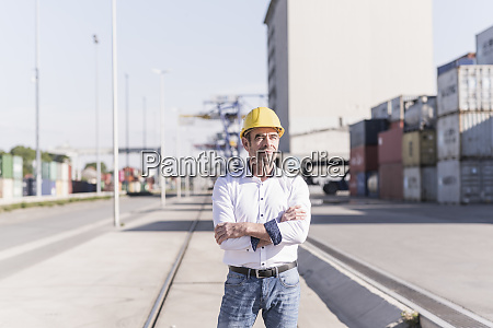 portrait of businessman wearing safety helmet