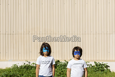 two brothers with painted blue masks