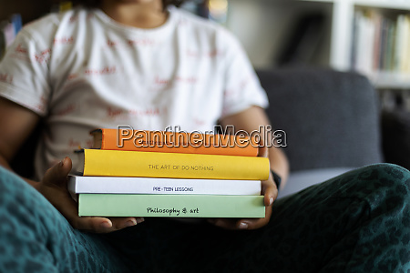 crop view of boy holding stack