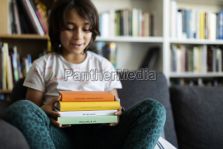 boy sitting on couch at home