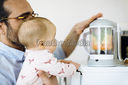 father showing his baby girl a