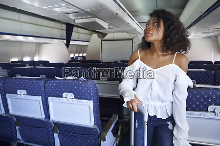 young woman searching seat while standing
