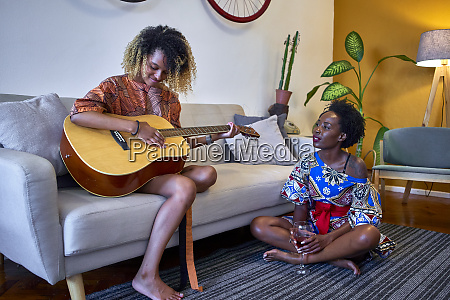 two women with guitar in the