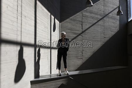 businesswoman wearing elegant suit standing on