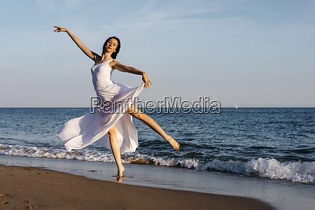 ballerina in white dress dancing at