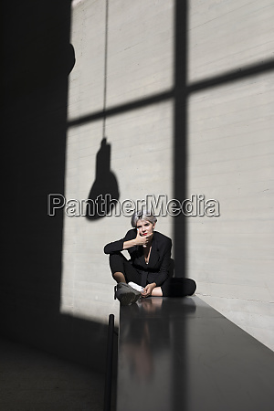stylish female professional wearing suit relaxing