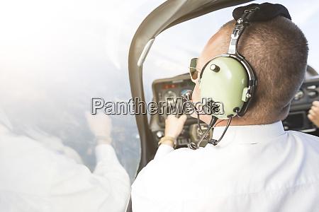 pilot flying in sports plane