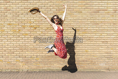 happy young woman jumping and holding