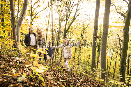 family enjoying autumn in forest