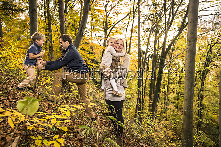 parents enjoying with children in forest