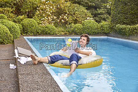 young man sitting on airbed in